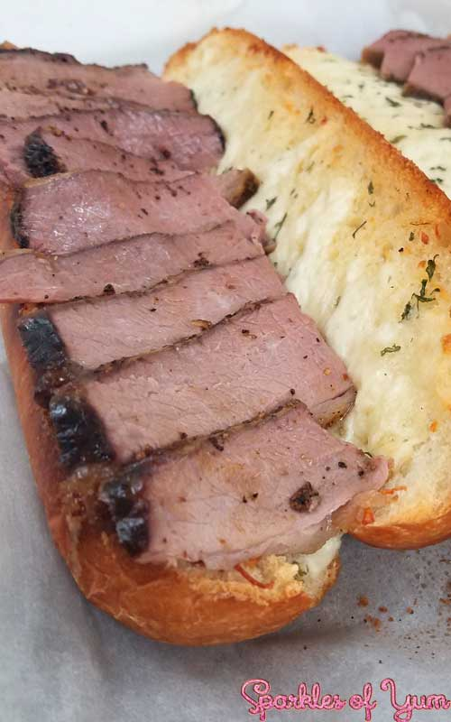 Slow wood smoked brisket on a cheesy garlic bread. You are going to fall in love with this sandwich.