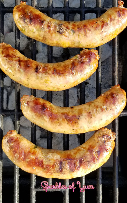 These Homemade Jalapeno Cheddar Brats are super-scrumptious! From that snap of the casing, the juiciness of the brat, how all the flavors come together, and the oh so good cheesy bits inside.