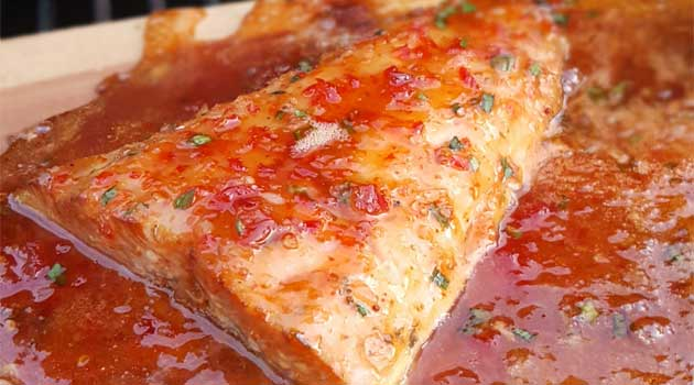 Sweet and spicy. Light and savory. This Grilled Salmon with Sweet Chili Glaze is a perfect example of mixing flavors together, and having them work together perfectly.