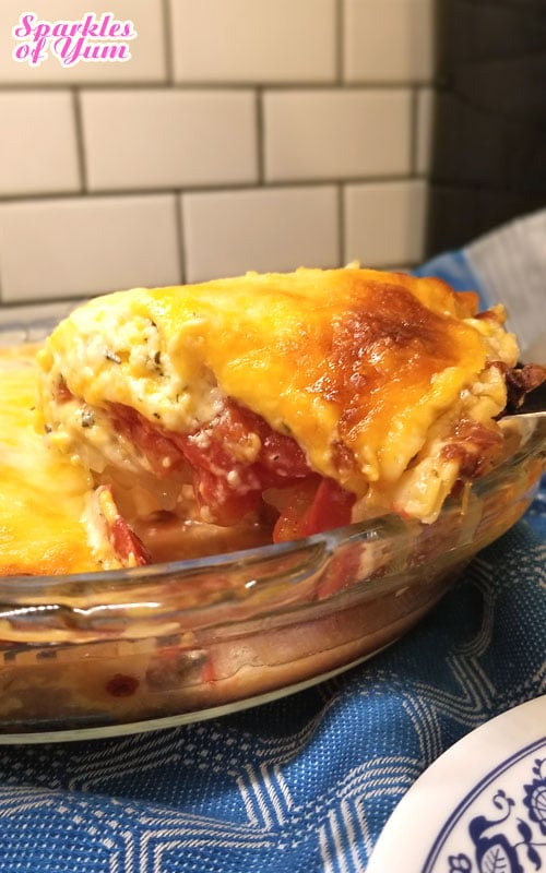 Recipe for Tomato Pie - This Tomato Pie recipe is just creamy, cheesy, tomato'y goodness in a pie crust. Bursting with the flavor of home grown tomatoes. I would almost dare to call this a TRUE pizza pie.