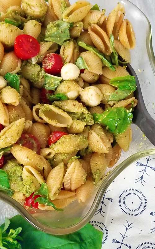 Perfect for potlucks, holidays, or when you just need to make a lot to feed a crowd. My new go to pasta salad is this Pesto Caprese Pasta Salad, loaded with fresh from the garden flavors! I just love the idea of a healthier, lighter pasta salad.