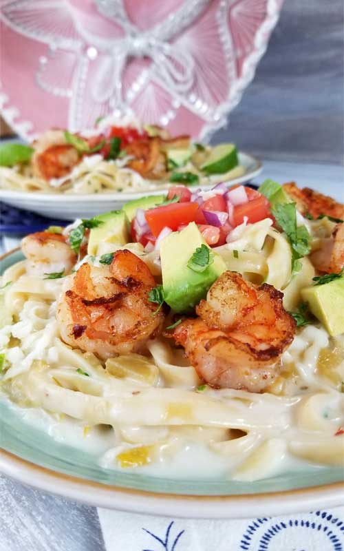 This is a simple, flavorful creation that's ready to party on your plate! Creamy cheesy sauce, buttery shrimp, and Pico De Gallo all make this Creamy Mexican Shrimp Pasta Recipe a love fest for your taste buds!