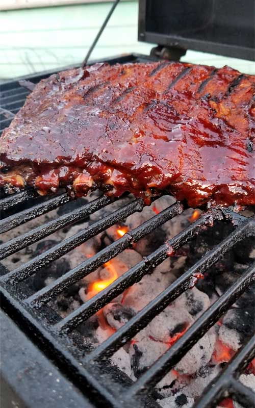 Perfectly sauced BBQ ribs on the grill