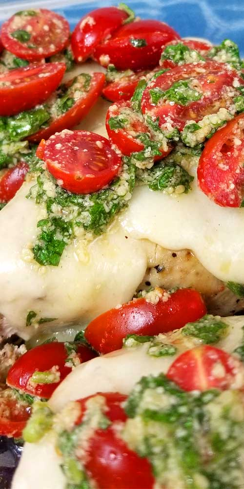 Fresh from the garden Chicken Margherita. Kinda like the Margherita pizza, same fresh and simple ingredients, only on top of a chicken breast instead of a pizza. An easy lemon, garlic and basil pesto topped with ripe cherry tomatoes turns an average chicken breast into a delightful summer dinner.