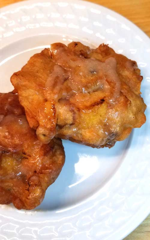When fresh peaches are at the farmers market, and it's too damn hot to turn the oven on, you make Peach Fritters with Honey Cinnamon Glaze!