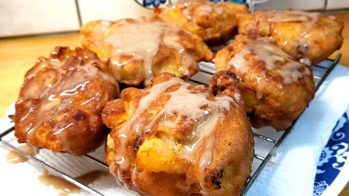 When fresh peaches are at the farmers market, and it's too damn hot to turn the oven on, you make Peach Fritters with Honey Cinnamon Glaze! And they are so good, you can't even come up with words for how good they are.