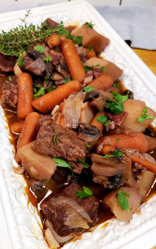 No knife needed, spoon tender, and so much flavor. You can't go wrong with this Instant Pot Beef Bourguignon, and it's EASY.