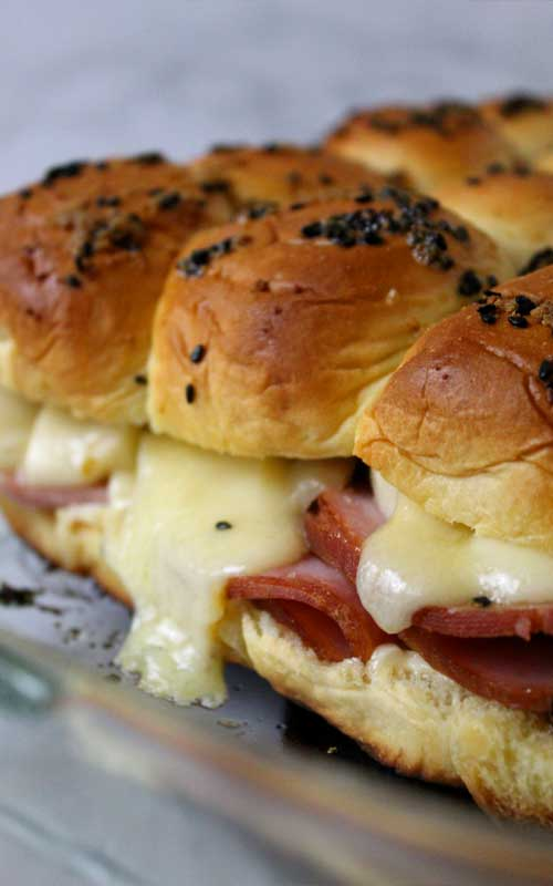 Sink your teeth into these Ham and Cheese Sliders and you won't be able to stop at one. They are so good, you'll want them at every party!