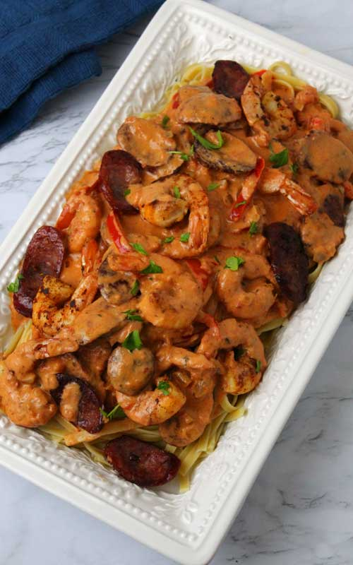 Creamy Cajun Shrimp and Sausage Pasta, is a celebration of flavorsin one outstanding dish. I totally thought it tasted like I had ordered from a restaurant. This sauce is absolute Cajun heaven!