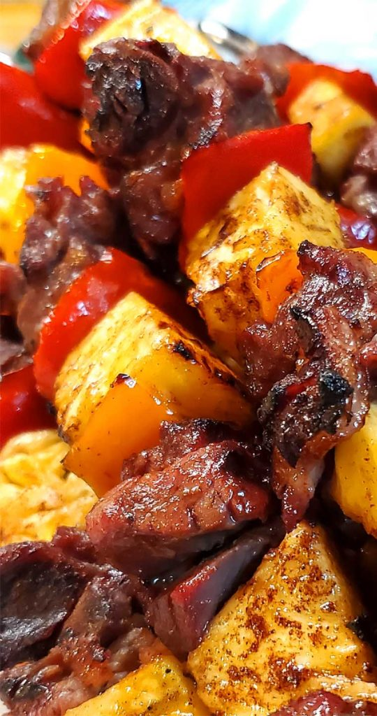 The grilled caramelized pineapple takes this dish over the top. These Brazilian Beef Kabobs with Pineapple and Peppers are very easy and so delish! Marinaded, smoky, and full of flavor goodness. #beef #grilling #Brazilian #pineapple #summer