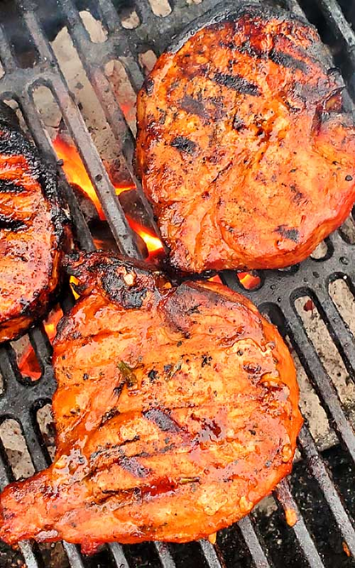 These Korean BBQ Pork Chops are packed with with a little sweet, a little heat, and a lot of juicy. A ton of smoky flavor and super tender. These are among some of the best pork chops we have ever ate! #grilling #porkchops #Korean #dinnerideas