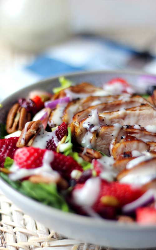 This Summer Strawberry Spinach Salad with Chicken is so tasty and refreshing for a hot day. It's simple, healthy, and incredibly delicious!