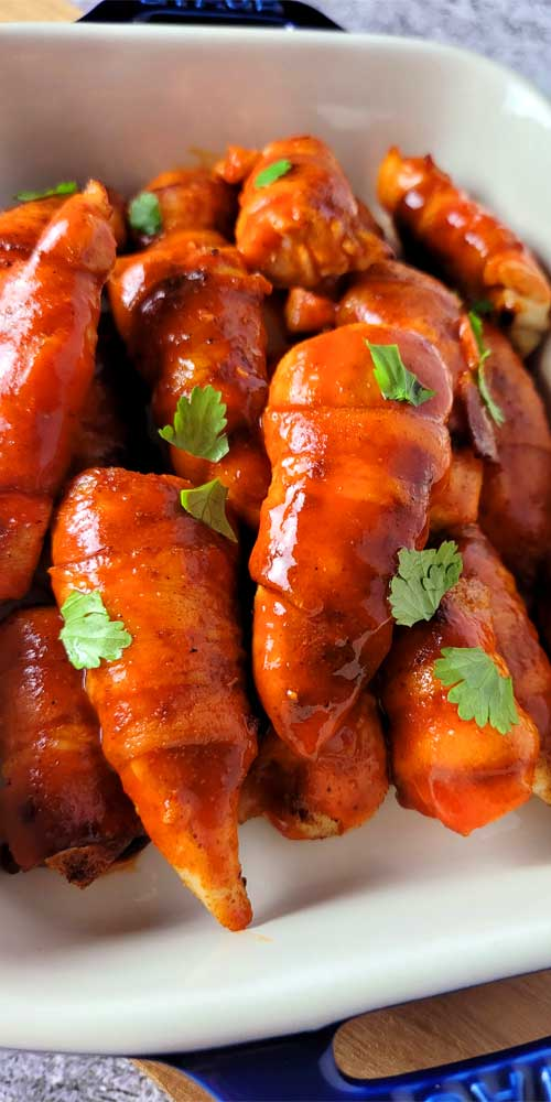 A perfectly snackable finger food, these Keto Bacon Wrapped Buffalo Chicken Tenders are perfect for any get together; be it the big game, family celebration, or even a shower.